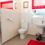 Photo of accessible WC with grab rails and wash basin in Cosaig self-catering Innerleithen