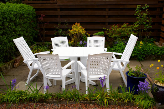 Image of table and six chairs in the garden of Cosaig self catering, holiday cottage, Innerleithen, Scottish Borders